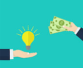 Hand holds money, hand holds light bulb. Investing in innovation, buy ideas, strategy, modern technology business concept. Modern flat design graphics for web sites, web banners, infographics.