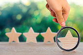 Four wooden stars. The concept of rating and evaluation. The rating of the hotel, restaurant, mobile application. Quality service, buyer choice. Success in business. selective focus