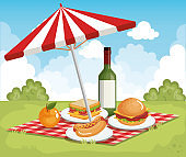 tableclothes picnic with umbrella and food scene