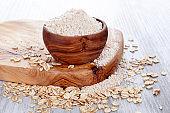 Oat flour in wooden bowl.