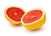 Two halves of grapefruit with shadows isolated on a white background