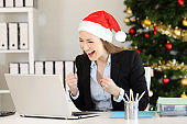 Excited office worker receiving good news in christmas