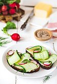 Sandwiches with butter, cucumbers, radishes and smoked salt.