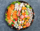 Sushi Set. Different sashimi, sushi and rolls