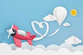 Paper art style of Pink plane and white balloon flying above Heart ribbon, Romantic, sweet, cute, Perfect Valentine's Day Cards for the loved ones in your life, 3D rendering design.
