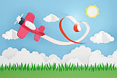 Paper art style of Heart ribbon with Pink plane flying in the sky, Romantic, sweet, cute, Perfect Valentine's Day Cards for the loved ones in your life, 3D rendering design.
