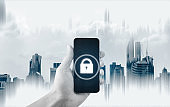 Mobile security system . Hand holding mobile smart phone with lock icon on screen