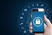 Mobile device security system. Hand holding mobile smart phone with lock and application icons. on blue background