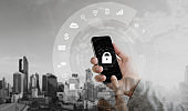 Mobile security system and internet application safety. Hand using mobile smart phone with lock and application icons