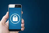Mobile application and internet online security system. Hand using mobile smart phone with lock icon