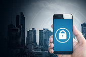 Mobile application and internet online security system. Hand using mobile smart phone and lock icons on screen