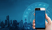 Hand holding mobile smart phone, and application icons technology