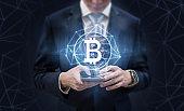 Online business, Cryptocurrency and Block chain business. Businessman using mobile phone and global network. Element of this image are furnished by NASA