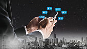 Double exposure, Businessman using mobile phone and notification icons
