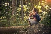 Backpacker in rainforest
