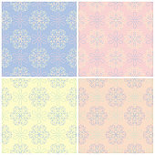 Set of faded colored seamless backgrounds with floral patterns
