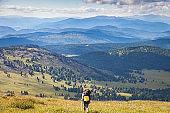 Stylish woman hiking