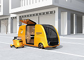 Self-driving pizza delivery van and drone in the street