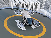 White self-driving passenger drone takeoff and landing on the helipad