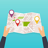 Hand holding a paper map with points. Tourist look at map of the city. Vector Illustration in flat design. Travel concept.