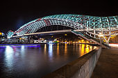 Pedestrian bridge of peace over the Mtkvari (Kura) River in Tbilisi at night