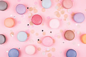 Group of pastel colorful macarons on trendy background