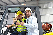 group of manager and worker in the logistics industry work in a warehouse with chemicals