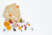 Christmas, happy new year composition. Christmas gifts, envelopes, christmas decorations, snowflakes on white background. Top view.
