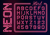 Realistic Neon red alphabet with neon numbers. Vector Neon typeset on dark background.  Glowing font for your design.