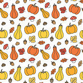 cute fall autumn seamless vector pattern background illustration with pumpkins, leaves, acorns, chestnuts and mushrooms