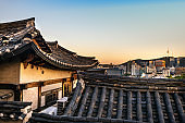 Old Seoul buildings with modern cityscape on the background