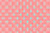 Small polka dots pattern on pink background