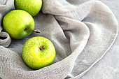 Fresh green apples on the table, close up.
