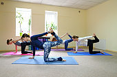Three young women in yoga classes