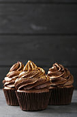 Chocolate cupcakes on grey wooden table