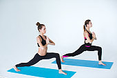 Two women exercising on fitness mats