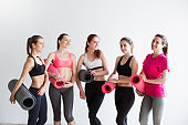Group smiling women after training in fitness studio.