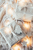Winter holiday Christmas decorations, white gift boxes and knitt