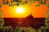 Luxury yacht on open sea at golden sunset view through leaves frame, Zadar, Dalmatia, Croatia
