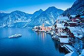 Hallstatt with ship in winter twilight, Salzkammergut, Austria