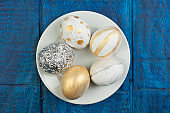 Happy Easter. Painted eggs on wooden table. Top view. Copy space for text