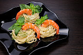 Nests of spaghetti with Parmesan flavored with dill, shrimp and basil.