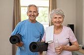 Active elderly couple ready for yoga