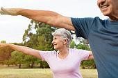 Senior couple doing stretching exercise