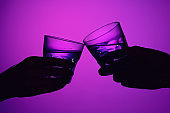 Two wine glasses and male and female hands