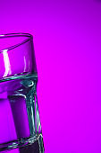 The water in glass on lilac background