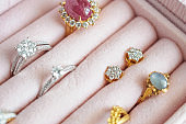 Gold and silver diamond gemstone ring and earrings in luxury jewelry box