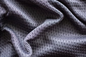Gray fabric sport clothing football jersey with air mesh texture background
