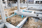 Pest control pipe system install at new house construction foundation for termite protection