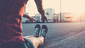 Woman stretching on the street, sport and workout at sunset